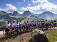 Switzerland-Day-2-Entire-Team-Posing-Standing-To-Side-Of-Bikes-With-Mountains-In-Back